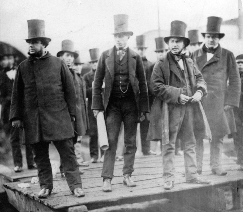 Isambard Kingdom Brunel stands second from right.