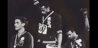 John Carlos and Tommie Smith give the black power salute during the medal ceremony at the 1968 Olympics. (YouTube)