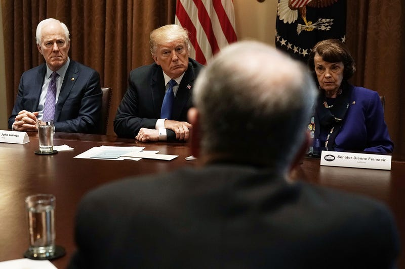 Senate Majority Whip John Cornyn (R-Texas), President Donald Trump and Sen. Dianne Feinstein (D-Calif.) during a meeting with bipartisan members of Congress at the Cabinet Room of the White House in Washington, D.C., on Feb. 28, 2018, in Washington, D.C.