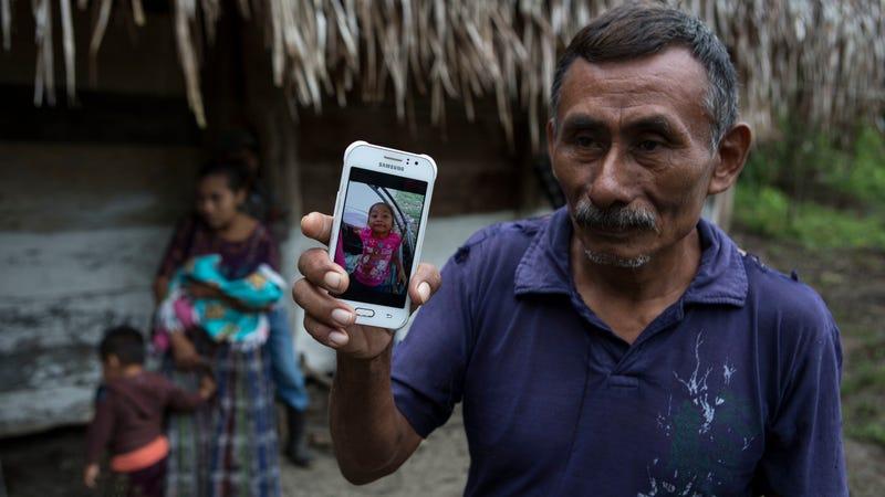 Domingo Caal Chub, 61, and a photograph of his granddaughter, Jakelin Caal Maquín.