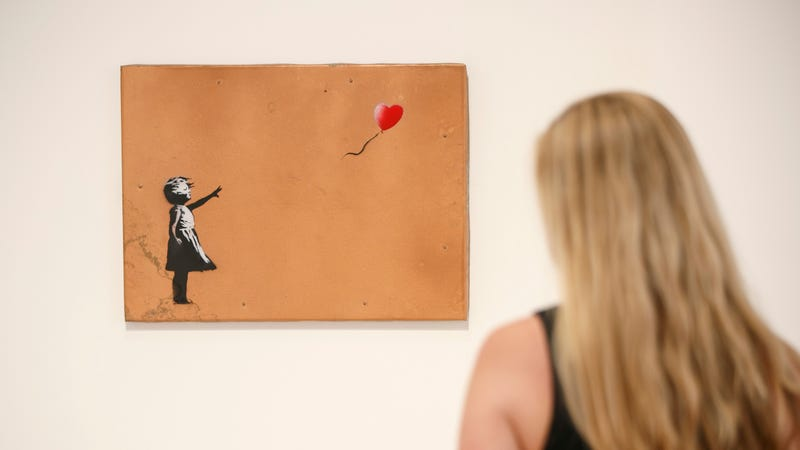 "Illustration for article titled Banksy booby-trapped one of his paintings to ""self-destruct"" at auction, and that's actually pretty funny"
