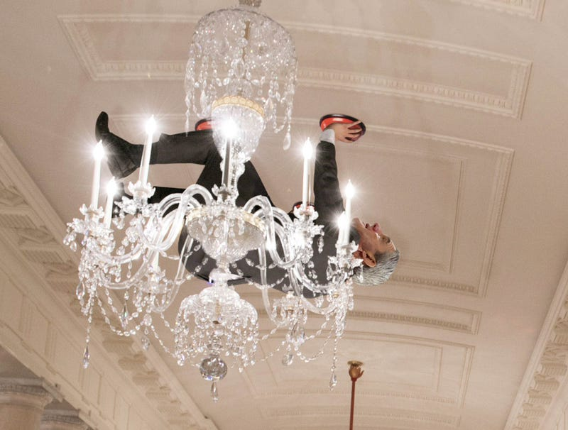 Illustration for article titled Suction Cup-Wearing Robert Mueller Forced To Cower Behind White House Chandelier After Trump Returns Home Earlier Than Planned
