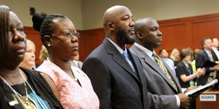 Trayvon's parents, who averted their eyes when the image of their son's dead body was shown during the trial (Getty Images)