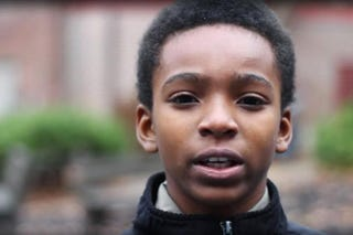 "Zarriel Trotter as he appeared in the Black Is Human campaign's video ""Real Talk""Black Is Human via YouTube screenshot"