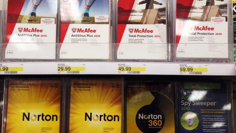 Boxes of McAfee security software are displayed alongside Norton Anti-virus software by Symantec on a shelf at a Target store August 19, 2010 in Colma, California.