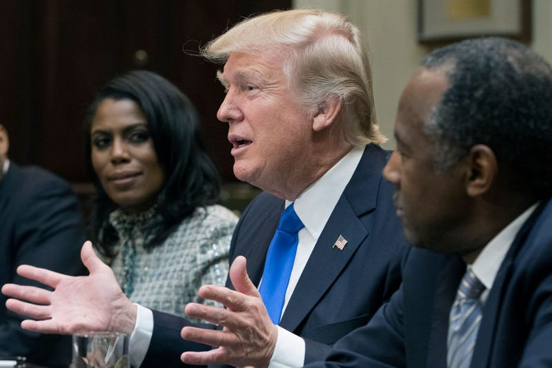 President Donald Trump with Omarosa Manigault (left) and Ben Carson (right) in the Roosevelt Room of the White House on Feb. 1, 2017 (Michael Reynolds-Pool/Getty Images)