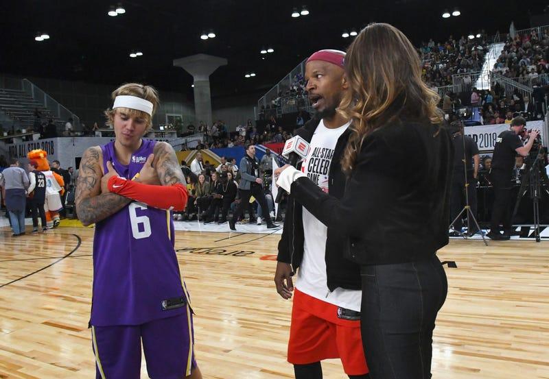 Justin Bieber and Jamie Foxx take the floor during player introductions prior to the 2018 NBA All-Star Game Celebrity Game on Feb. 16, 2018, in Los Angeles. (Jayne Kamin-Oncea/Getty Images)