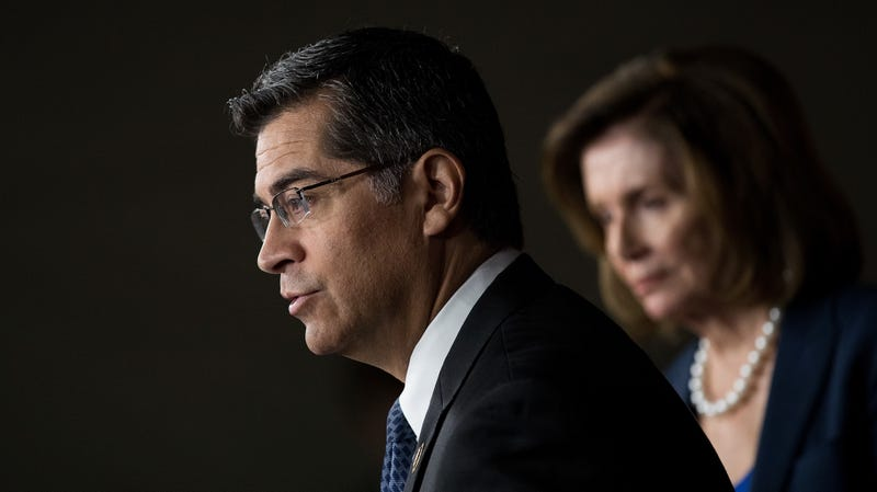 Xavier Becerra, now California state attorney general, speaks as House Minority Leader Nancy Pelosi (D-CA) looks on during a news conference to discuss the rhetoric of presidential candidate Donald Trump, at the U.S. Capitol, May 11, 2016, in Washington, DC.
