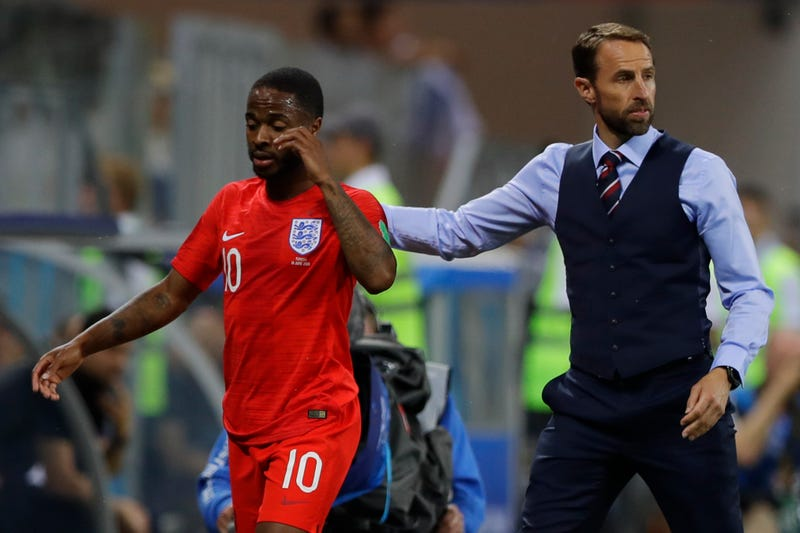 Gareth Southgate walks off Raheem Sterling after subbing him out against Tunisia.