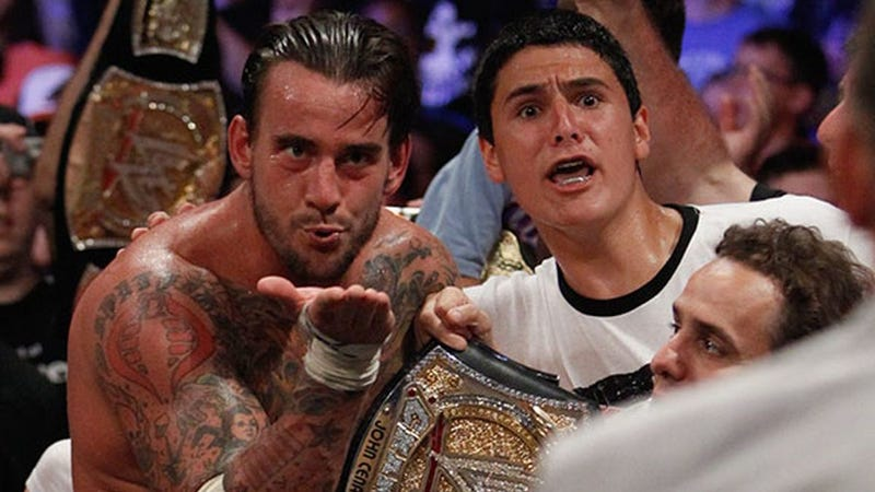 CM Punk blows Vince McMahon a kiss at Money in the Bank 2011.
