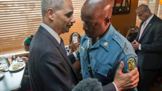 U.S. Attorney General Eric Holder talks with Capt. Ron Johnson of the Missouri State Highway Patrol at Drake's Place Restaurant Aug. 20, 2014, in Ferguson, Mo.Pablo Martinez Monsivais-Pool/Getty Images