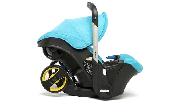 A Car Seat With Retractable Stroller Wheels Frees Up Trunk