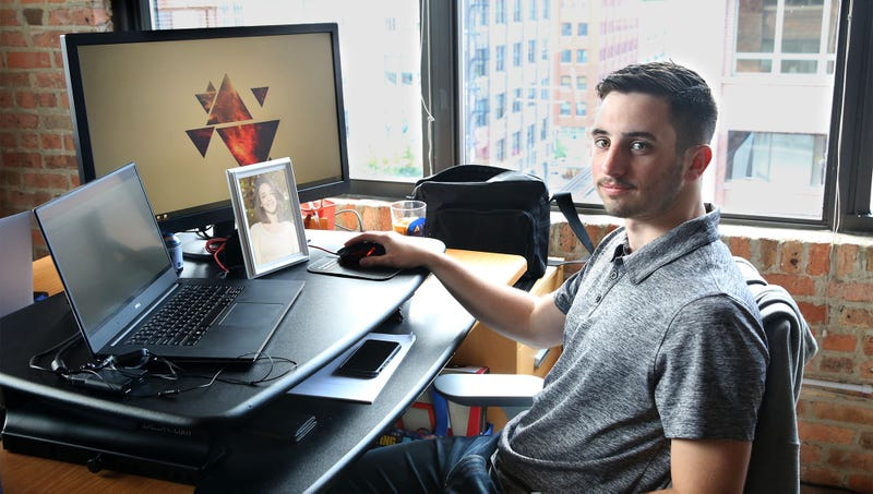 Illustration for article titled 27-Year-Old Unsure Whether He Can Pull Off Keeping Framed Picture Of Wife On Desk