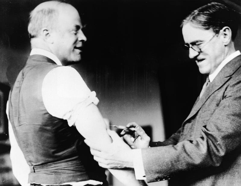 Everyone who can should get their goddamn flu shot already. (Photo: A doctor inoculates Major Peters of Boston against the Spanish Influenza virus during the epidemic, c. 1918. Hulton Archive/Getty Images)