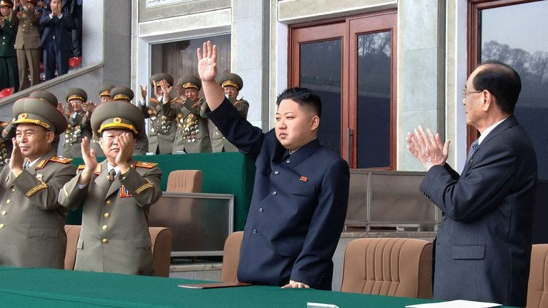 Thousands cheer Dear Leader Kim Jong-un's triumph of being the first man to walk on the moon.