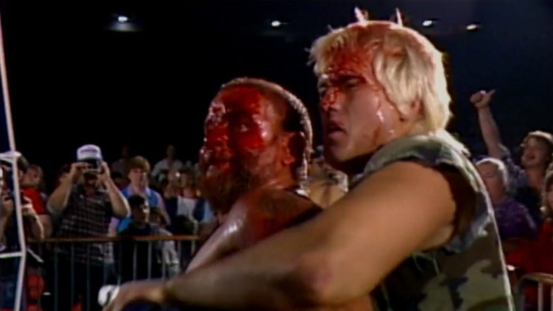 Bloodied and battered, Sheepherders flag bearer Jack Victory holds back Luke Williams at the first annual Crockett Cup in New Orleans.