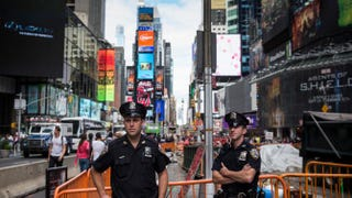 Two police officers patrol Times Square on Sept. 22, 2013, in New York City. Andrew Burton/Getty Images