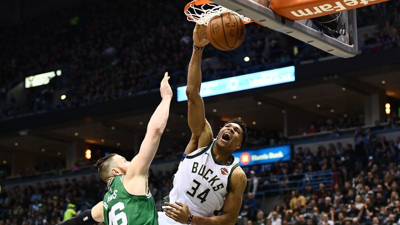 Giannis Antetokounmpo dunks over Aron Baynes of the Boston Celtics on Sunday.