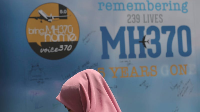 A girl stands in front of a condolence message board during a Day of Remembrance for MH370 event in Kuala Lumpur, Malaysia, Sunday, March 3, 2019. Five years ago, Malaysia Airlines Flight MH370, a Boeing 777, had gone missing the day before while over the South China Sea with 239 people on board.