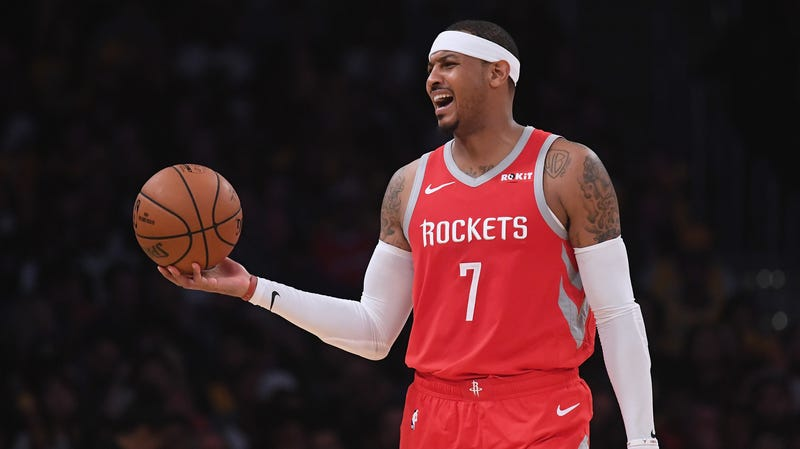 Illustration for article titled Report:The Rockets Have Stuffed Carmelo Anthony Into The Closet Behind The Vacuum Cleaner