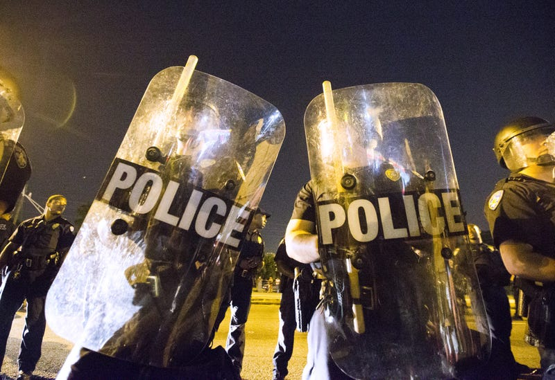Protesters face off with  police in riot gear across the street from the Baton Rouge, La., Police Department on July 8, 2016, in the wake of the fatal police shooting of Alton Sterling.Mark Wallheiser/Getty Images