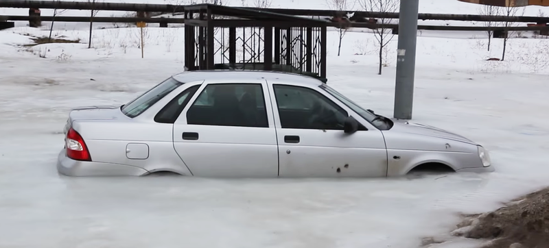 Illustration for article titled Meanwhile In Russia, A Lada Got Completely Iced