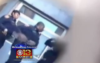 Image from cellphone footage showing officer slapping a young manCBS Baltimore screenshot