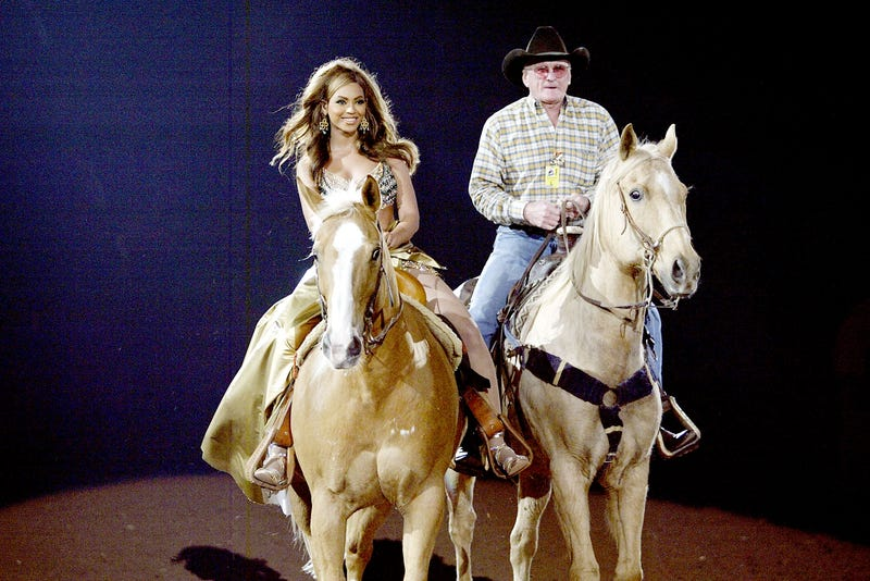 Beyoncé arrives on horseback to perform for her hometown crowd at the Houston Livestock Show and Rodeo on March 18, 2004. (Frank Micelotta/Getty Images)