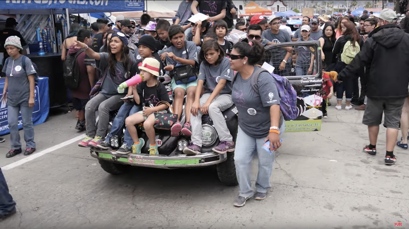 There's a race car under that pile of kids! (Image Credit: SCORE)