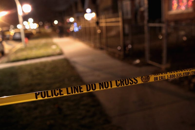 Police investigate the scene of a shooting where a 23-year-old woman was shot in the chest and hand and a 25-year-old man was shot in the leg on Jan. 1, 2017, in Chicago. The two were shot just before midnight on Dec. 31, 2016, making them the last of more than 4,000 people shot in the city in 2016 and ending one of the most violent years in the city in two decades.Scott Olson/Getty Images