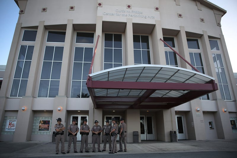 Florida Highway Patrol officers stand outside the Curtis M. Phillips Center for the Performing Arts on the University of Florida campus in Gainesville on Oct. 18, 2017, as they prepare the venue for a scheduled speech by white nationalist Richard Spencer. (Joe Raedle/Getty Images)