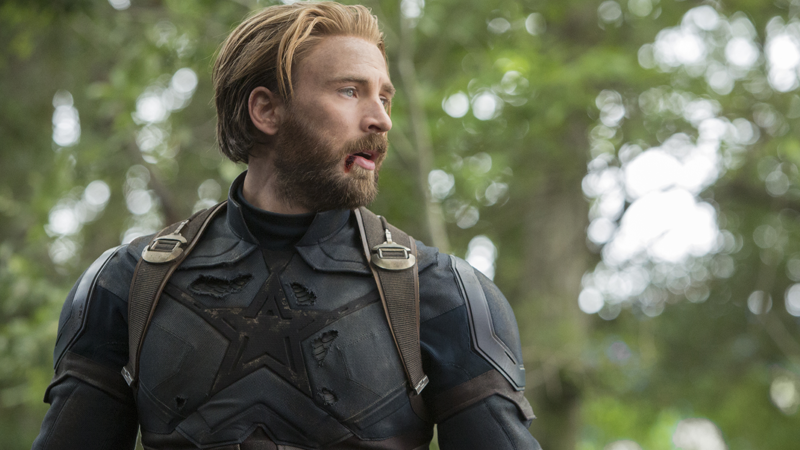 Chris Evans as the exhausted, bloodied, and majestically hairy Captain America in Avengers: Infinity War.