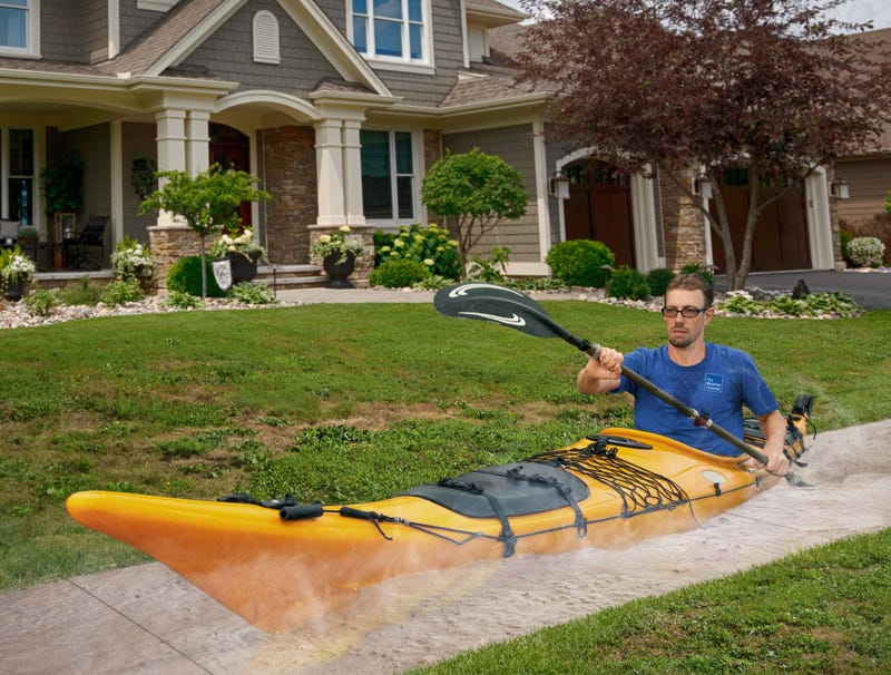 Illustration for article titled Weather Channel Correspondent Paddling Boat Through Melted Sidewalk To Show Off Extent Of Heat Wave