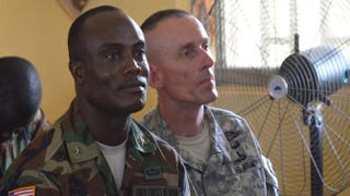 On Nov. 10, 2014,Maj. General Dabiel Ziankhan, Liberia's army chief of staff,and Maj. Gen. Gary Volesky, commander of American forces in Liberia, attend an indoor ceremony in a new Ebola treatment center built by the U.S. Army in Tubmanburg, the provincial capital of Bomi County in western Liberia.ZOOM DOSSO/Getty Images