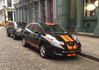 Illustration for article titled Ironic Or Iconic? Nissan Leaf With Orange Racing Stripes