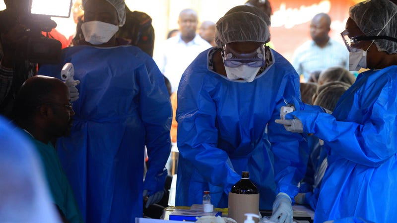 Healthcare workers from the World Health Organization prepare to give an Ebola vaccination to a front line aid worker in the Democratic Republic of Congo earlier this month.