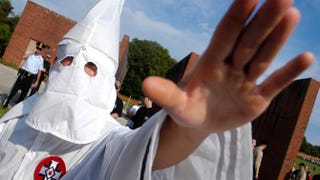 A member of the Ku Klux Klan salutes during American Nazi Party rally at Valley Forge National Park September 25, 2004 in Valley Forge, Pennsylvania.William Thomas Cain/Getty Images
