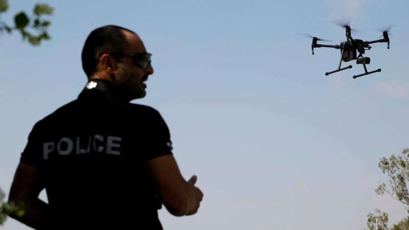 A police officer with the Sovereign Base Areas of Akrotiri and Dhekelia, British territories on the island of Cyprus that house numerous UK military facilities, testing a drone designed to cut down on illegal poaching of migratory birds in 2017.