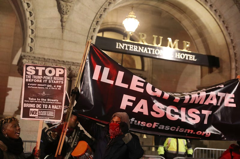 """Protesters stand in from of the Trump International Hotel in Washington, D.C., Jan. 17, 2017, as they hold a rally """"to prevent the Trump-Pence regime from coming to power."""" (Joe Raedle/Getty Images)"""