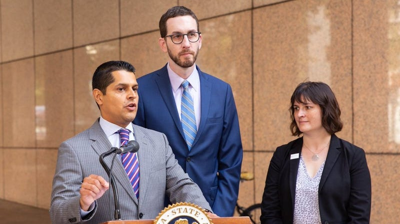 Assemblyman Miguel Santiago and Senator Scott Wiener urge California Governor Jerry Brown to sign Senate Bill 822 at a press conference on Thursday, Sept. 30, at the Ronald Reagan State Building in Los Angeles.