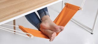 Illustration for article titled An Under-Desk Hammock For Your Feet Is the Best Office Upgrade