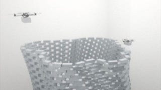 Illustration for article titled Quadcopter Fleet Builds the Leaning Tower of Styrofoam