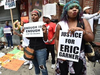Protesters gather at the spot where Eric Garner died as they rally against police brutality in Garner's memory Aug. 23, 2014, in Staten Island, N.Y. STAN HONDA/AFP/Getty Images