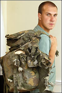 Illustration for article titled Soldier Uses Body to Shield Comrades from Grenade Blast, Survives Thanks to Backpack