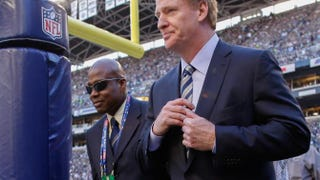 NFL Commissioner Roger Goodell (foreground) walks the sidelines prior to the game between the Seattle Seahawks and the Green Bay Packers at CenturyLink Field on Sept. 4, 2014.Otto Greule Jr./Getty Images