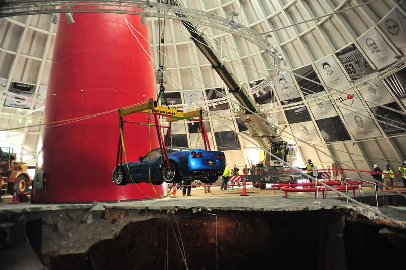 Illustration for article titled Check Out These Amazing Photos From The Corvette Sinkhole Recovery