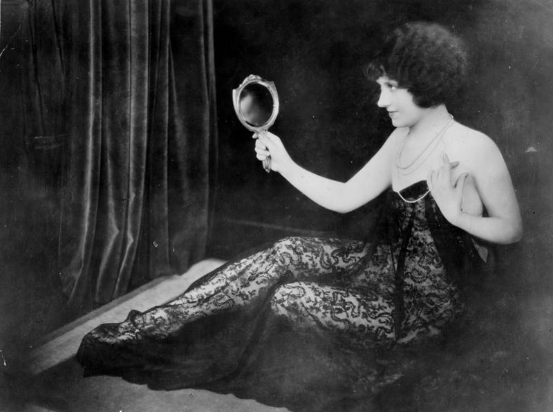 Illustration for article titled And Here's a Silent Film Actress Posing All Casually Scandalous