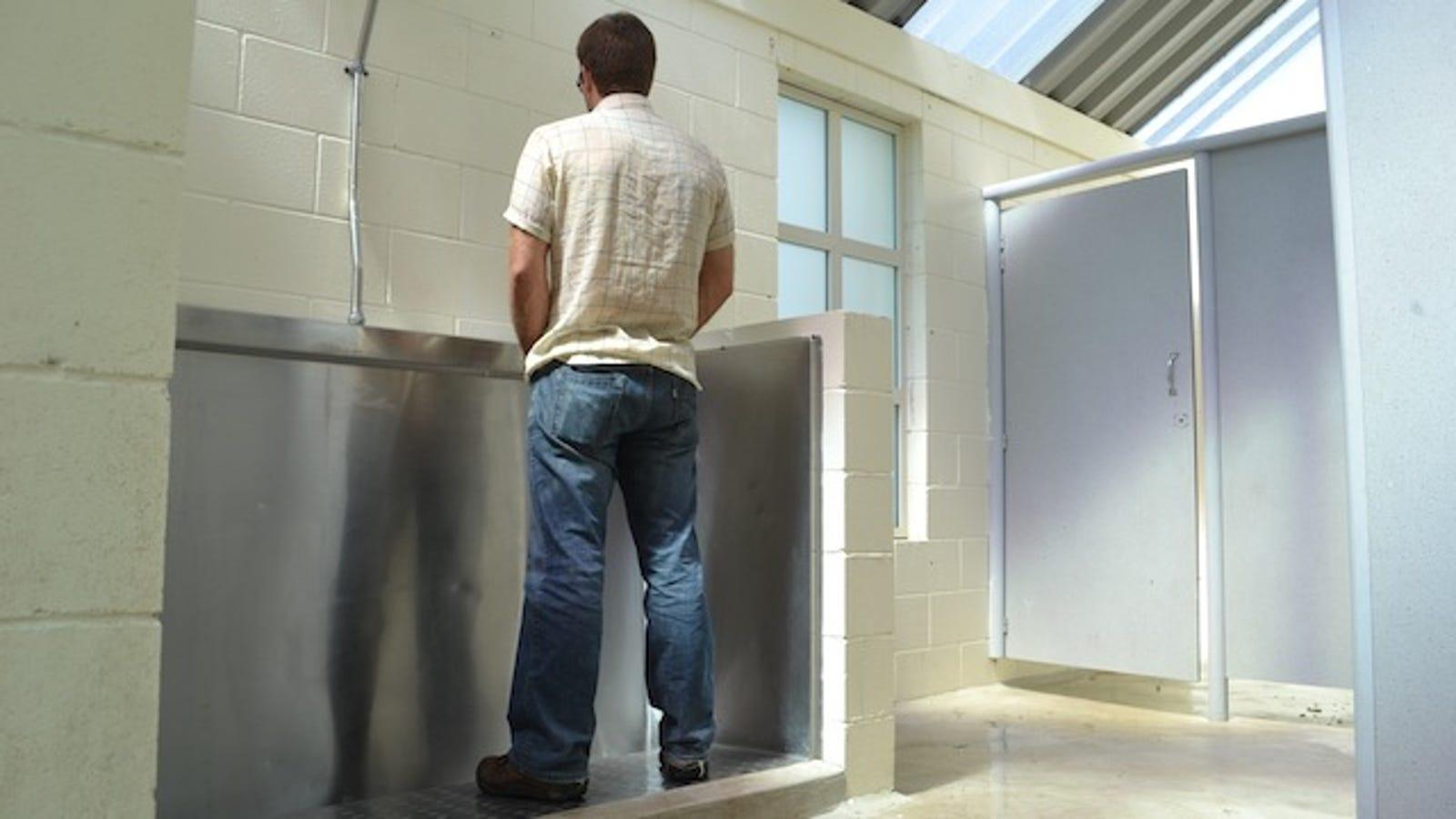 Men peeing trough
