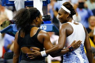 Serena Williams hugs Venus Williams after defeating her in their women's-singles quarterfinals match on day 9 of the 2015 U.S. Open Sept. 8, 2015, in New York City. Al Bello/Getty Images