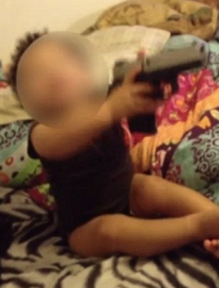 Indiana couple arrested after video surfaced of the woman's 1-year-old daughter playing with a handgun.YouTube Screenshot